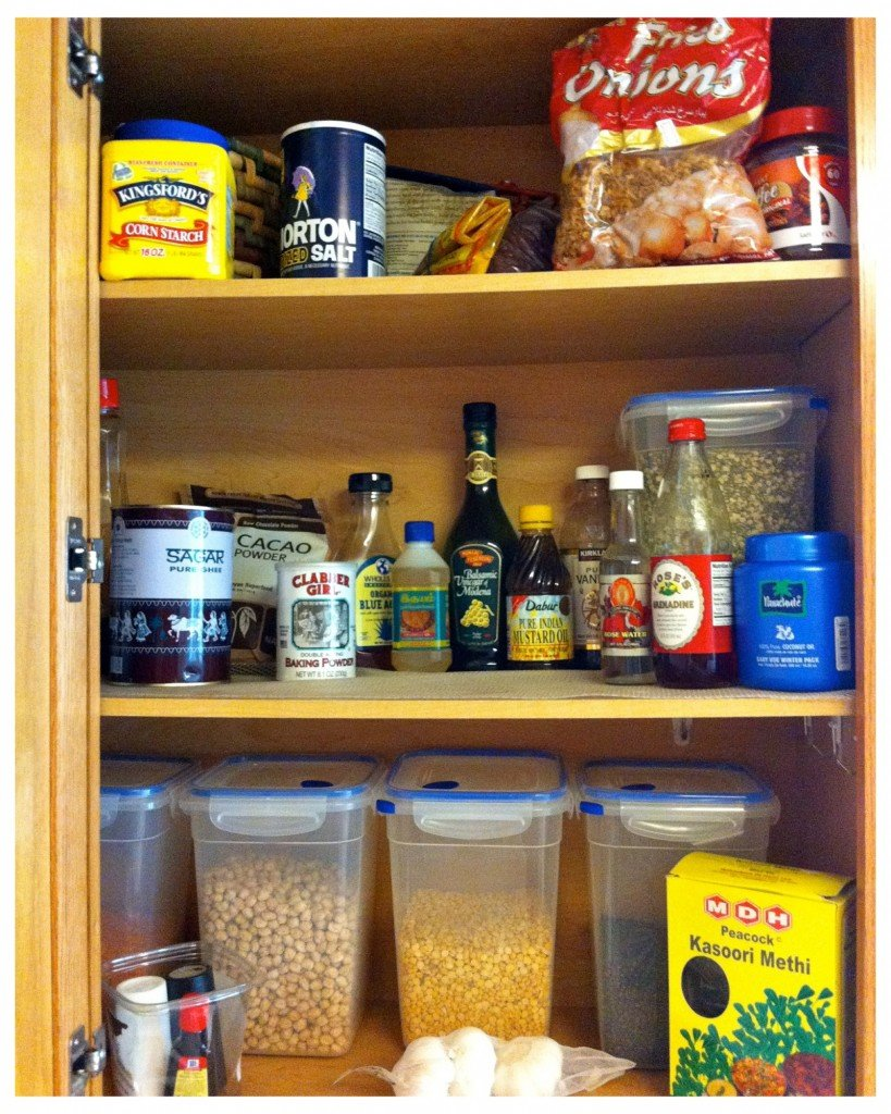 Unorganized cabinet of cooking oils like coconut oil, mustard oil and my all-time favorite ghee