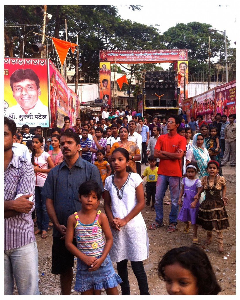 Crowds begin to gather for the final puja.